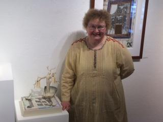 KN Goodrich Poses Next to Her Work